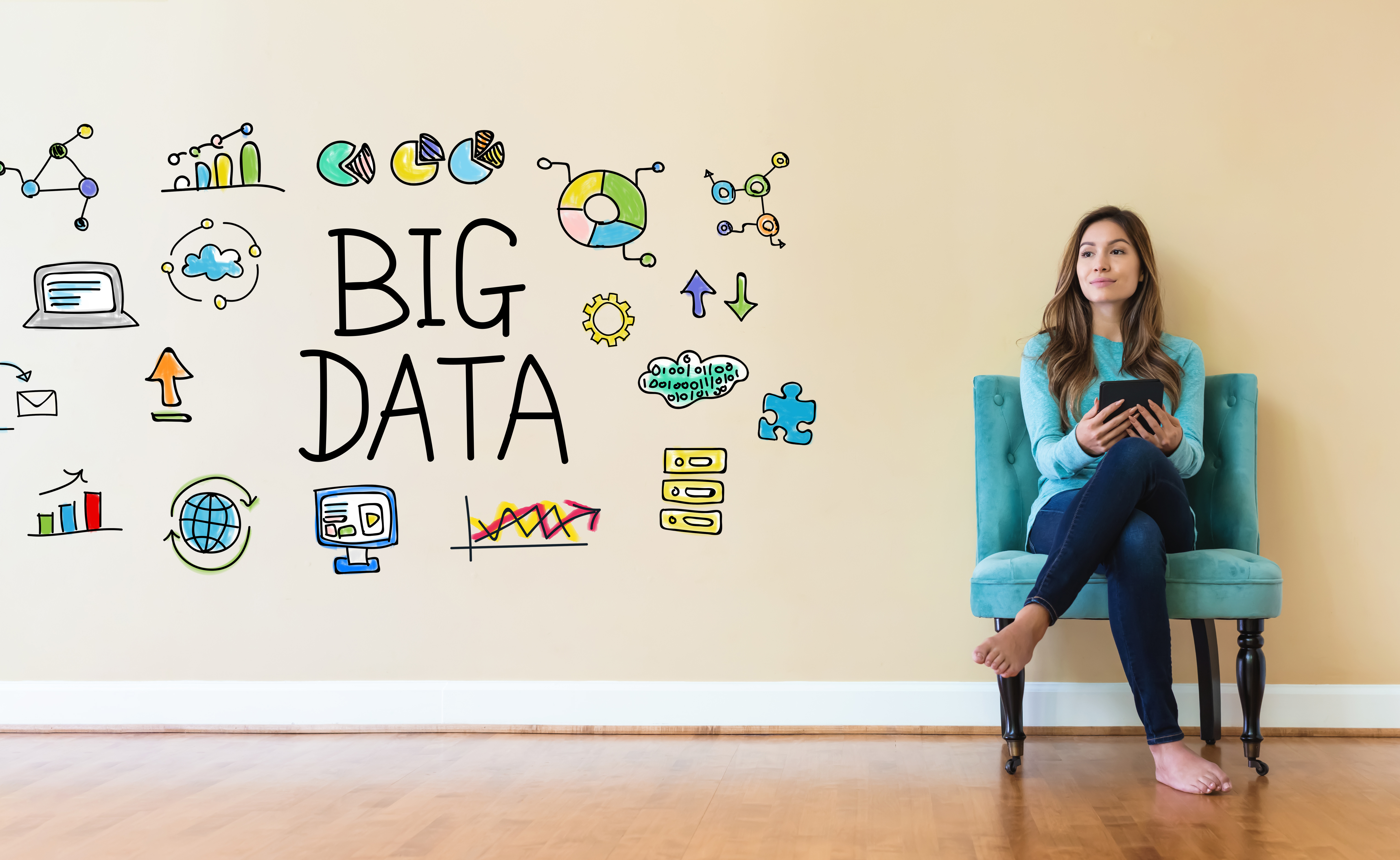 Big Data text with young woman holding a tablet computer in a chair
